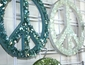 Broken recycled glass PEACE sign